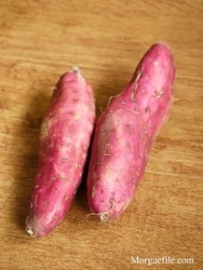 Red sweet potato roots on table